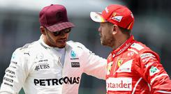 Fierce rivals: Lewis Hamilton and Sesbastian Vettel