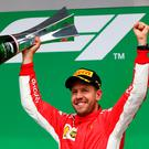 Number one: Sebastian Vettel celebrates after winning the Canadian Grand Prix