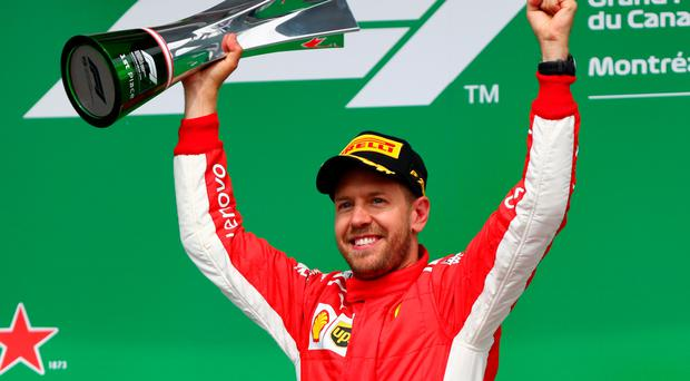 Number one Sebastian Vettel celebrates after winning the Canadian Grand Prix