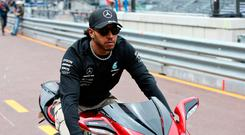 New wheels: Lewis Hamilton arrives at the paddock in Monaco on his scooter