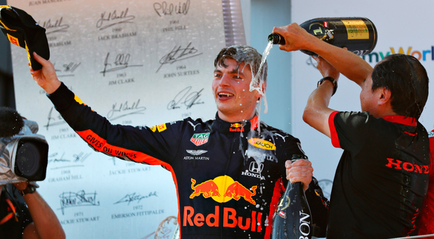 Drinking it in: Max Verstappen celebrates on the podium