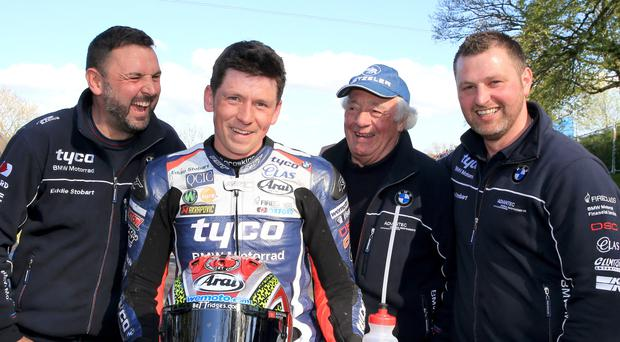 Happier times: Dan Kneen celebrates his win at the Tandragee 100 at the start of May