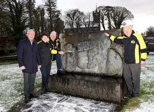Monumental effort: at the Armoy Armada monument are four people who are instrumental to the running of the Armoy Road Races, (left to right) Trevor Kane, owner of the Bayview Hotel and title sponsor, Jean McPherson, club chair, Bill Kennedy, clerk of the course and Mick Colgan, club president