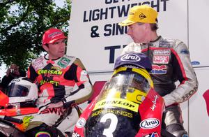Lasting memory: Joey and Robert Dunlop share the winners' enclosure after the 2000 125cc TT. Joey won and Robert was third. It was their last race together