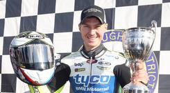 Dream ending: Christian Iddon shows off the Sunflower Trophy after his last race for Tyco BMW
