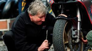 Man at work: Joey tinkers with his race bike at the North West 200. Photo: Stephen Davison