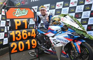 On top: Peter Hickman celebrates after setting a new world record lap speed of 136.415mph in last year's Superbike race