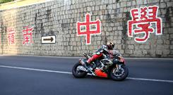 Eastern promise: Peter Hickman (Aspire Ho BMW) at Maternity Bend during the first practice session for the 2019 Macau Grand Prix