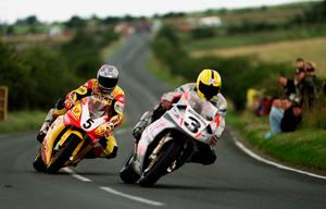 Fond memories: David Jeffries (V&M R1 Yamaha) follows in the wheel tracks of Joey Dunlop on the Honda RC45 at the Ulster Grand Prix in 1999