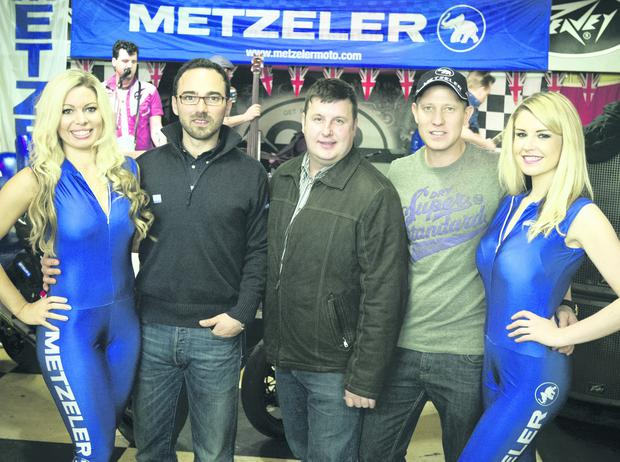Brand Manager at Metzler, Enrico D'Aloja, James Courtney, President of Dundrod & District Motorcycle Club, and road racer Gary Johnson, with the Metzler girls at the announcement of the new sponsorship deal