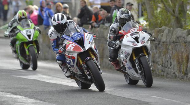 Solitary brother: William (6) and eventual winner Michael Dunlop battle around village streets in Armoy Race of Legends