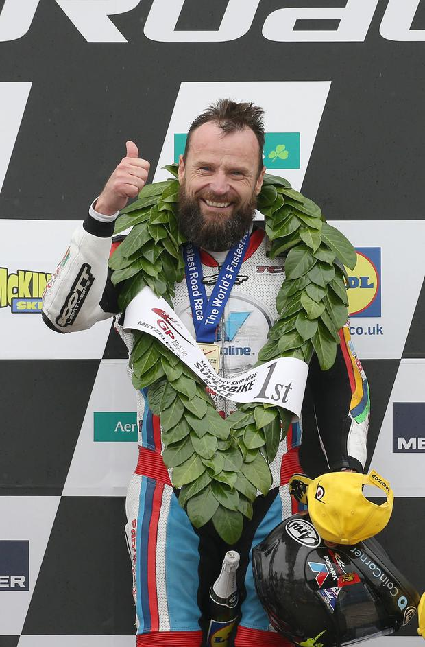 All smiles: Bruce Anstey grins after Ulster Grand Prix success