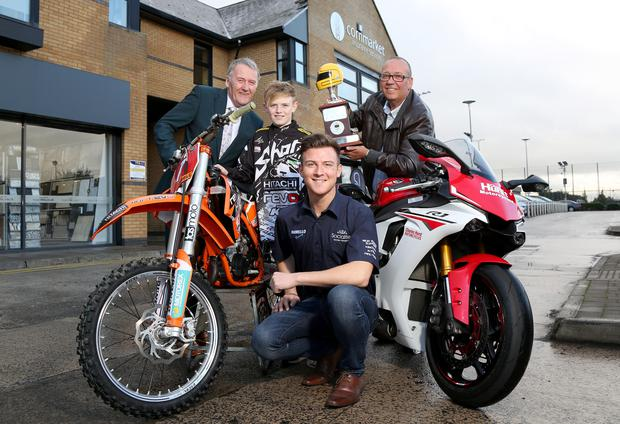 Winners: Josh Elliott and Curtis Trimble help launch the Cornmarket Motorcycle Awards with title sponsor Sam Geddis and David Weir of the Enkalon Motorcycle Club.