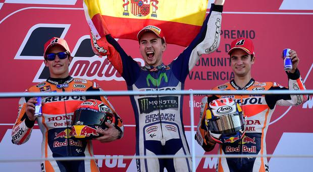 Champion: Jorge Lorenzo, celebrating after winning in Valencia and becoming MotoGP world champion, is joined on the podium by Marc Marquez (left) and Dani Pedrosa