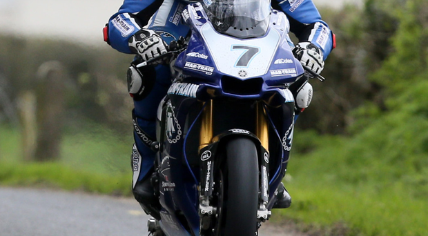 Leading the way: Dan Kneen en route last night to taking pole position for the Superbike race at the Tandragee 100