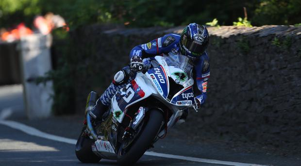 Powering ahead: Ian Hutchinson recorded the first 130mph lap of this year's Isle of Man TT on his Tyco BMW Superbike