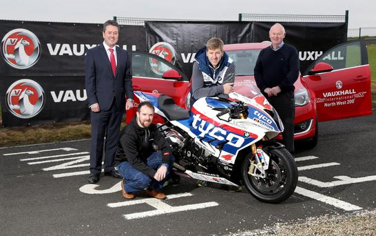 Road to glory: Top riders Alastair Seeley (second left) and Ian Hutchinson (second right) with NW200 Event Director Mervyn Whyte (right) and Vauxhall chief Gordon Hannen