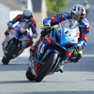 Road to success: Michael Dunlop won his first race of the week in Monday's Monster Energy Supersport race.