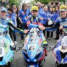 Shake on it: race winner Michael Dunlop (centre), runner-up Peter Hickman (right) and third place Dean Harrison (left)