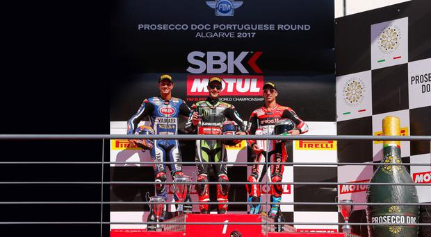 Centre stage: Jonathan Rea on Portimao podium with Michael van der Mark (left) and Marco Melandri (right)
