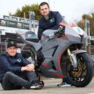 Main men: John McGuinness (seated) has joined forces with Michael Dunlop for the TT this year