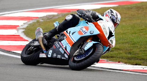 Full throttle: Australian rider David Johnson on the orange and blue Gulf BMW during the recent Donington BSB round