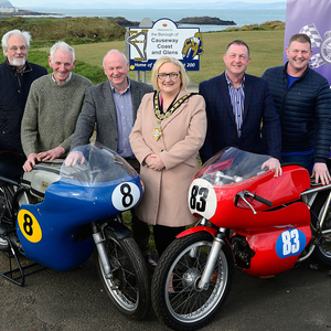 Parade lap: Bushmills road racing legend Dick Creith, Mayor of Causeway Coast and Glens Cllr Brenda Chivers, NW200 Event Director Mervyn Whyte, John and Keith Miller of sponsors Breda Tyre and Exhaust Centre, and vintage display co-ordinator Will Corry launch the special display and parade of former winners' machinery to mark the North West's 90th anniversary