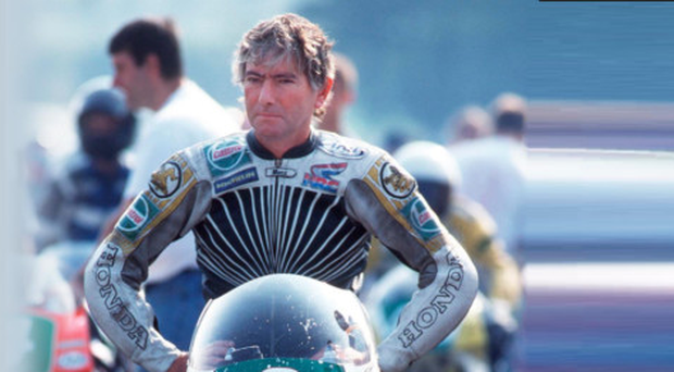 Legend: Joey Dunlop lost in his thoughts at the 1995 Ulster Grand Prix