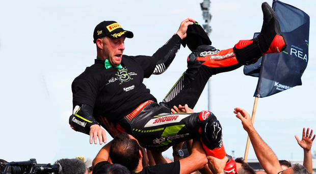 High five: victorious Jonathan Rea is hoisted aloft by team-mates after another world title win