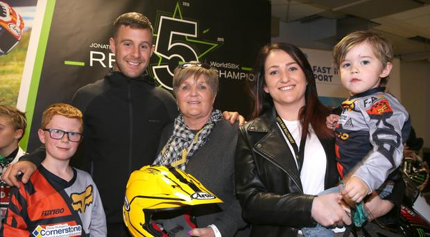 Homecoming heroes: Jonathan Rea arrives back home after clinching his fifth World Superbike crown where he was greeted at Belfast International Airport by Linda Dunlop, wife of Joey, also a five-time world champion. Also included is Joey's daughter, Joanne and his grandsons Hayden and Herbie