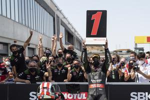 First again: Jonathan Rea joins his Kawasaki team in celebration of yesterday's win at Aragon