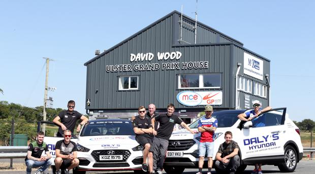 Ready to roll: Lee Johnston (third from left) is joined by (from left) Adam McLean, Davy Todd, Conor Cummins, Joey Thompson, Noel Johnston UGP Clerk of the Course, Dean Harrison, Dominic Herbertson and Peter Hickman as they announce Daly's Garage as the official vehicle partner to this year's MCE Insurance Ulster Grand Prix