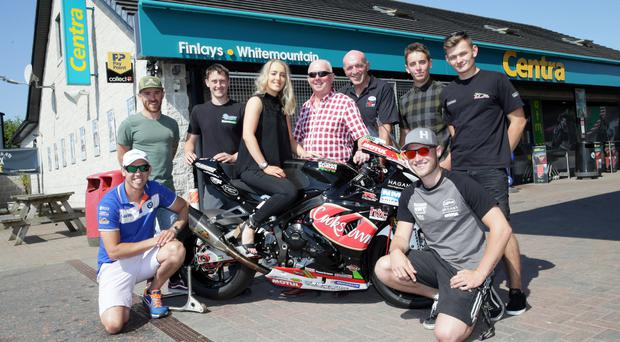 Dream machine: Davey Todd (front right) with Danielle Finlay from Centra Whitemountain, sponsor of the Superbike race on Saturday, August 11, on his bike; they are joined by (from left) Peter Hickman, Lee Johnston, Dean Harrison, Sam Finlay of Centra Whitemountain, MCE Ulster Grand Prix Clerk of the Course Noel Johnston, Dominic Herbertson and Joey Thompson