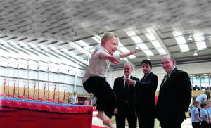 High flier: Wallace pre-preparatory pupil Evan Dorritt demonstrates his vaulting skills to Lord Coe, Cllr Thomas Beckett of Lisburn City Council and the city's Mayor, Alderman William Leathem, at Salto Gymnastics Centre