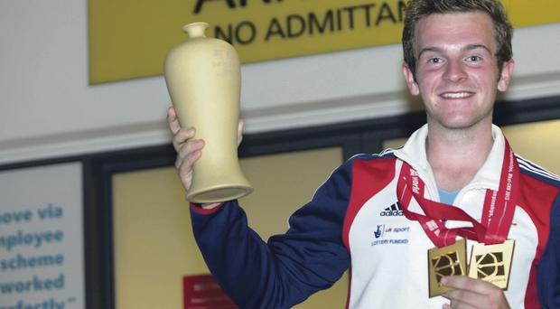 Patrick Huston with the two gold medals he won in China