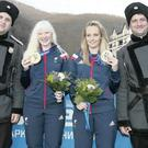 Kelly Gallagher (left) and guide Charlotte Evans get their hands on the gold medals after their superb run