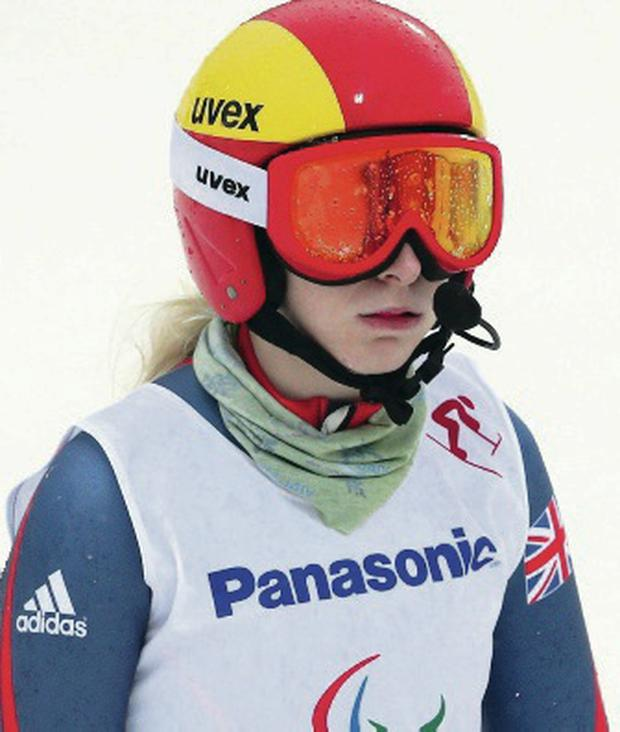 Agony: Kelly Gallagher is dejected after falling in Sochi yesterday