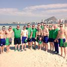 Happy as sand boys: Irish Olympians, including Belfast boxers Paddy Barnes and Michael Conlan, soak up the sun on Rio's famous Copacabana beach yesterday