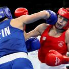 First to the punch: Katie Taylor (right) and Mira Potkonen trade blows in the Riocentro yesterday