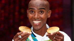 Glittering double: Mo Farah with his pair of gold medals from the Rio Games