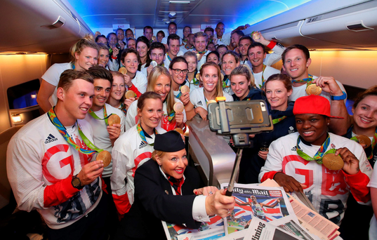 All smiles: Gold medalists of Team GB pose for a selfie with a member of British Airways cabin crew prior to flying back from Rio