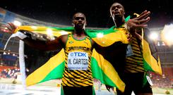 Verdict: Nesta Carter (left), who has tested positive, and Usain Bolt have both been stripped of relay golds