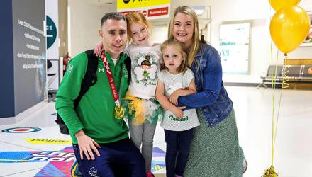 Jason Smyth arrives home at Belfast City Airport to his wife Elise and daughters Lottie and Evie. Credit: INPHO/Presseye/Kelvin Boyes