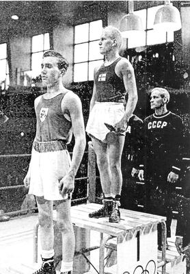 John McNally (left) receiving a silver medal at the 1952 Games