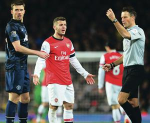 What's wrong? Arsenal's Jack Wilshere argues with referee