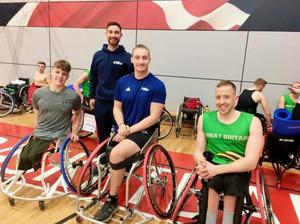 Teaming up: Disability Sport NI wheelchair basketball performance officer Phil Robinson (back) with Northern Ireland wheelchair basketball stars (from left) Conn Nagle, Ross Davidson and James MacSorley
