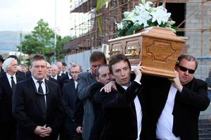 Sad loss: Ken Doherty carries the coffin of Alex Higgins followed by Jimmy White