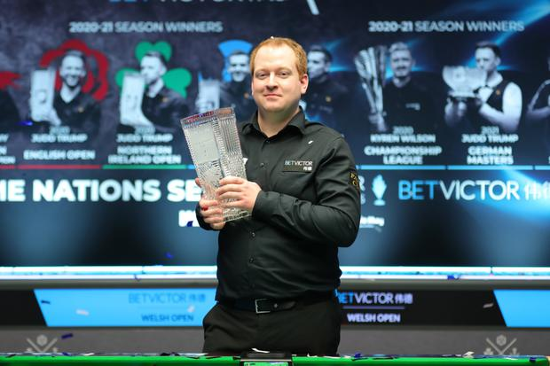 Prize guy: Northern Ireland cueman Jordan Brown proudly shows off the Welsh Open title after his against-the-odds triumph