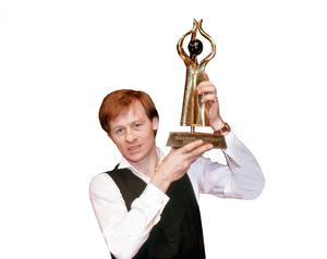 Alex Higgins with the Irish Masters trophy
