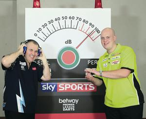 Make some noise: Phil Taylor (left) and Michael van Gerwen test the clapometer ahead of tonight's Premier League darts at the Odyssey